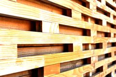 Wooden horizontal cells texture. Interesting texture of yellow bleached wooden square elements forming network or grille. Selective focus with shallow dof royalty free stock photos