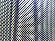 Interesting thin metallic perforated surface Stock Image