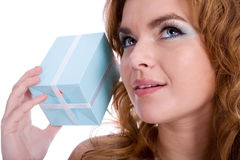 Interesting thing. Girl holding present and guessing what inside Stock Photography