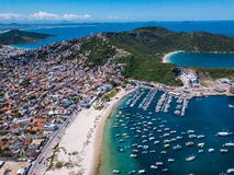 Beautiful city Arraial do Cabo Brazil. Praia dos Anjos. Aerial drone photo from above. Mountains ocean and fishing boats. Interesting uncharted brazilian tourist stock photo