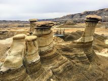 An interesting and unique view of the hoodoos outside of Drumheller, Alberta, Canada. A hoodoo is a tall, thin spire of rock royalty free stock images