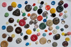 Interesting variety of many bright colorful variety of round buttons, different textures, diameter, on a white background Stock Photo