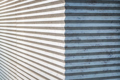 Interesting wall with zigzag texture. On a sunny day Stock Photos