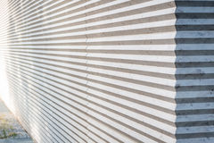 Interesting wall with zigzag texture. On a sunny day Royalty Free Stock Image