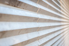 Interesting wall with zigzag texture. On a sunny day Stock Image