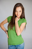 Interesting woman in green Royalty Free Stock Image