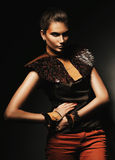 Interesting woman in leather accessories. In dark Royalty Free Stock Photography