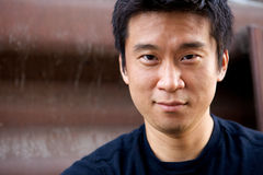 Interestng Asian Man. Portrait of an interesting asian man with an honest face Royalty Free Stock Images