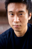 Interestng Asian Man. Portrait of an interesting asian man with an honest face Stock Image