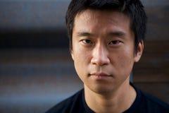 Interestng Asiat-Mann Stockfoto