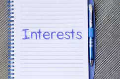 Interests write on notebook Stock Photo