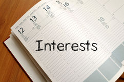 Interests write on notebook Royalty Free Stock Images