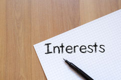 Interests write on notebook Royalty Free Stock Photo