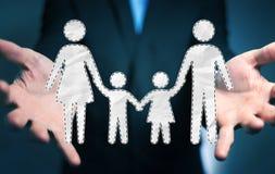 Interfaccia della famiglia della tenuta dell'uomo d'affari nella sua rappresentazione della mano 3D Immagini Stock Libere da Diritti