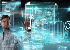 Interfaccia di tecnologia ed aria commovente dell'uomo d'affari davanti alle interfacce della costruzione 3D Fotografia Stock