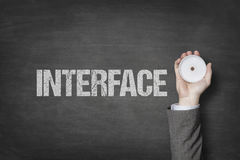 Interface text with businessman hand on blackboard Royalty Free Stock Photo