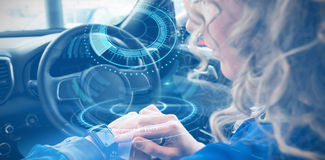 Composite image of interface of volume knob. Interface of volume knob against close up of woman using smart watch in car Royalty Free Stock Photos