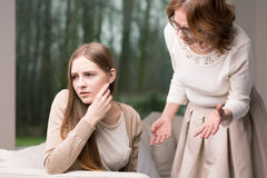 Intergenerational argument between mother and daughter. Concerned mother arguing with her teenage troubled daughter Stock Photos