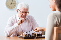 Intergenerational duel at chess Royalty Free Stock Photo
