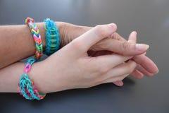Intergenerational friendship bracelets Stock Images