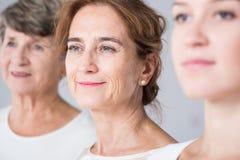 Intergenerational friendship between women. Photo of intergenerational friendship between three related women Stock Image