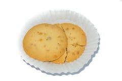 Interi biscotti dei grani su fondo bianco Fotografie Stock
