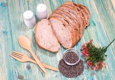 Interi semi del pane e di chia del grano Fotografia Stock