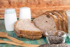 Interi semi del pane e di chia del grano Immagine Stock Libera da Diritti
