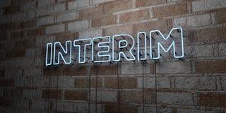 INTERIM - Insegna al neon d'ardore sulla parete del lavoro in pietra - 3D ha reso l'illustrazione di riserva libera della sovrani illustrazione di stock