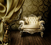 Interior. Beautiful Old-Styled Interior with Luxury Armchair & silk Curtain royalty free stock images