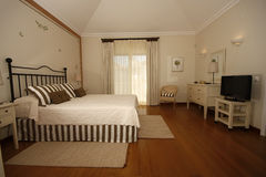 Interior. A luxurious and modern decorated bedroom Royalty Free Stock Photo