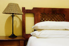Interior #6. Interior of room with bedside lamps, wooden bed and white duvet cover Stock Images
