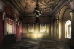Interior of an abandoned casino. Sunlight shines through the windows and lights the darkness Royalty Free Stock Image