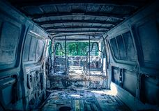 Interior of abandoned destroyed automobile stock image