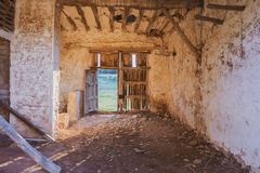 Interior of abandoned and dilapidated house with broken wooden door stock photography
