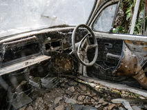 Interior of abandoned old car with spider web. Damaged dashboard, creepy and  gloomy atmosphere, scary background Royalty Free Stock Photo