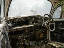 Interior of abandoned old car with spider web. Damaged dashboard, creepy and  gloomy atmosphere, scary background Royalty Free Stock Image