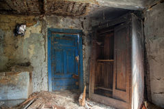 Interior of abandoned and ruined house Stock Photos