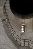 Interior of abandoned tower. Interior of abandoned water tower, bow stairway, light windows Royalty Free Stock Photo