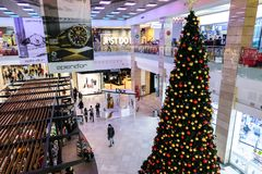 Interior of AFI Cotroceni Shopping Mall, Bucharest during holiday season. Big Christmas tree seen from above. BUCHAREST, ROMANIA - December 26 2017: Interior of royalty free stock photography