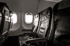 Interior of airplane with empty seats and sunlight at the window. Travel concept Royalty Free Stock Image