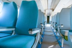Interior of an airplane with many seats Royalty Free Stock Photos