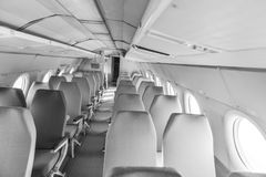 Interior of an airplane with many seats Royalty Free Stock Images