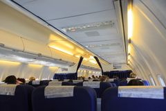 Interior of airplane and passenger seats. Interior of an airplane and passenger seats Royalty Free Stock Photo