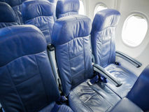 Interior of airplane passenger seats. Royalty Free Stock Images