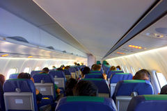 Interior of airplane with passengers Stock Images