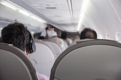 Interior of airplane with passengers Royalty Free Stock Photo