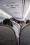 Interior of airplane with passengers Stock Photos