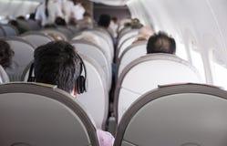 Interior of airplane with passengers Stock Photo