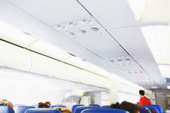 Interior of airplane with passengers on seats. Royalty Free Stock Images
